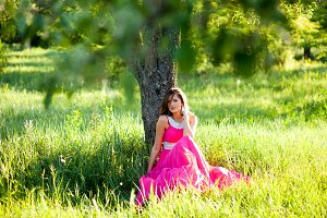 Woman in a long pink dress