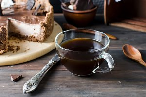 Chocolate cheesecake and cup coffee