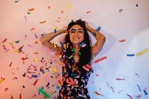 Woman under confetti