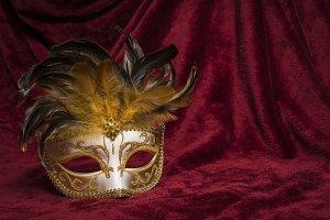 Mask on a red velvet curtain
