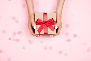 Hands holding present box