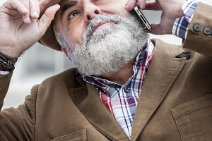 Attractive old man with beard and ha