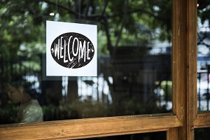 Welcome sign on a glass window
