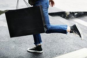 Woman carrying a shopping bag