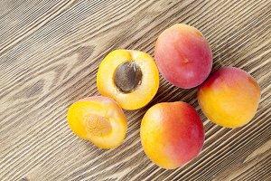 four ripe apricots