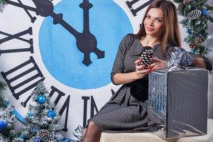 Girl and a Christmas gift.