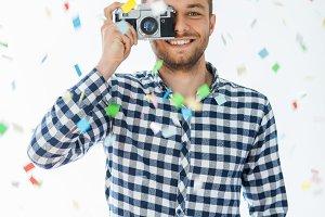 man taking photo with retro camera