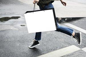Woman carrying a shopping bag(PNG)