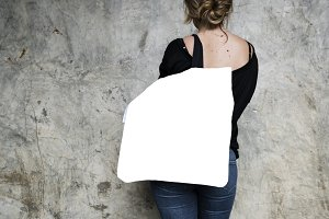 Woman carrying a tote bag(PNG)