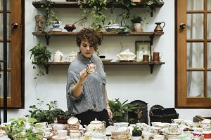 Woman choosing some tea cups