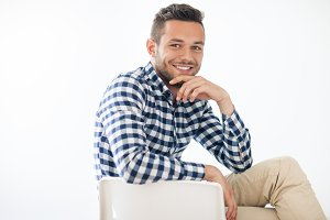smiling man sitting on chair