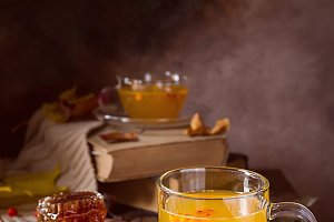 Sea buckthorn tea in a glass cup