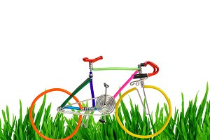 bicycle model toy wire grass isolated on white background