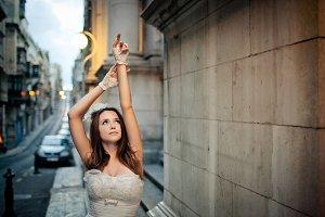 Bride raises her hands up