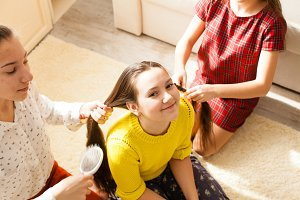 Girlfriends doing hairstyle