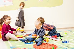 Three kids playing with toys
