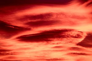 red sunset sky with clouds background