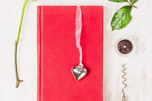 Composing with book, heart, red rose