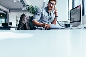 Businessman talking on landline