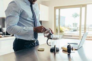Businessman preparing coffee