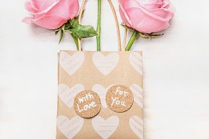 Pink roses in bag with love