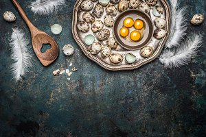 Quail eggs and cooking spoon