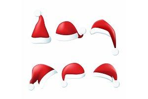 Set of red Santa Claus hats.