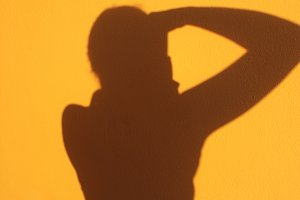 Shadow of photographer against wall