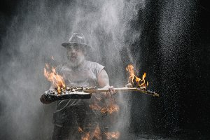 man with guitar fire