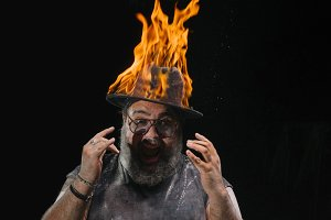 man wearing a hat with fire