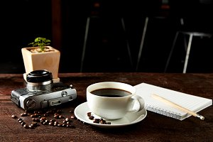 coffee camera and smartphone on wooden table