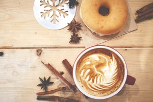 Cup of coffee with donut and Christmas