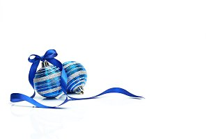 Blue Christmas ball with ribbon bow on white background
