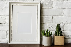 empty frame on wooden table