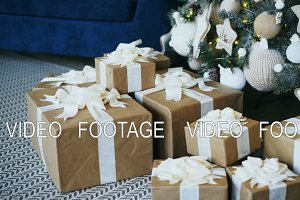 Pan shot of Christmas tree and gift box decoration at home