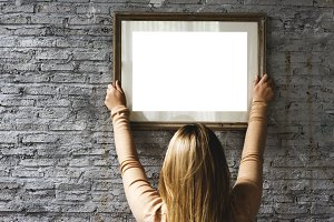 woman hanging photo frame (PNG)