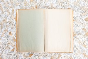 old opened book on paper background