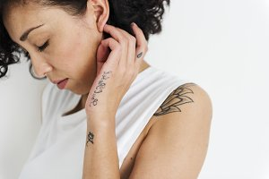 A Caucasian woman with tattoo
