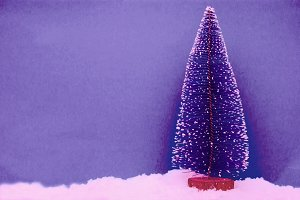 christmas tree in the snow on blue background