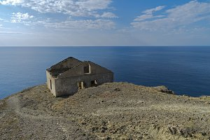 Old ruined house above the sea.