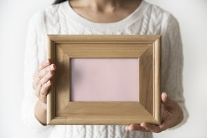 Woman holding picture frame (PSD)
