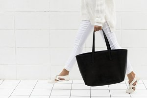 Woman with black tote bag