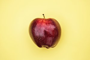 Apple on yellow background