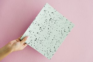 Hand holding dots paper