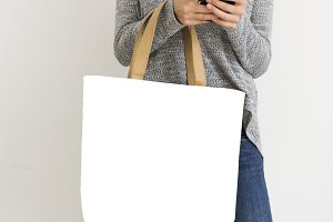 Woman holding mockup bag (PNG)