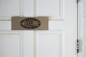 Welcome board on a door