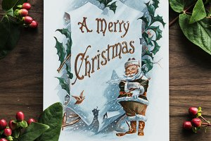 Christmas card on wooden table (PSD)