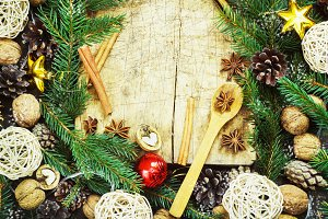 old cutting board with christmas attributes on a wooden kitchen background