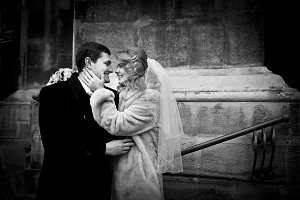 Bride holds groom`s face