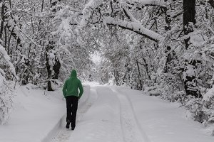 Man walking in a path in the snow